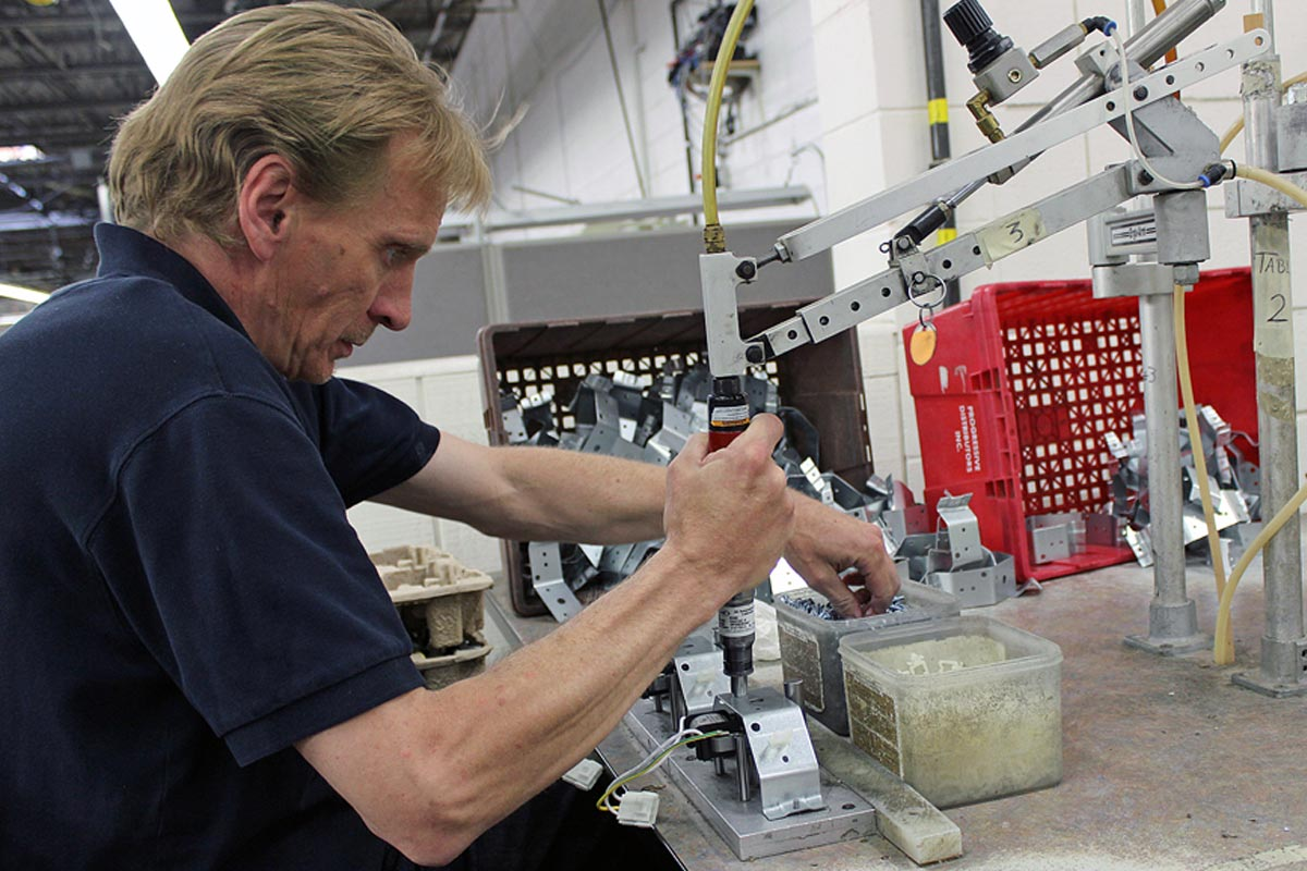 ELECTROLUX RELIES ON RISE WORKERS TO ASSEMBLE MORE THAN 6,000 COMPONENTS EACH DAY