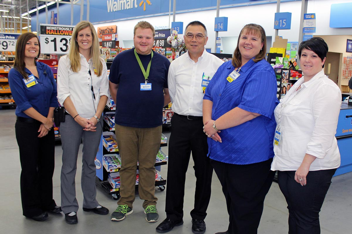 walmart worker smiling in team photo