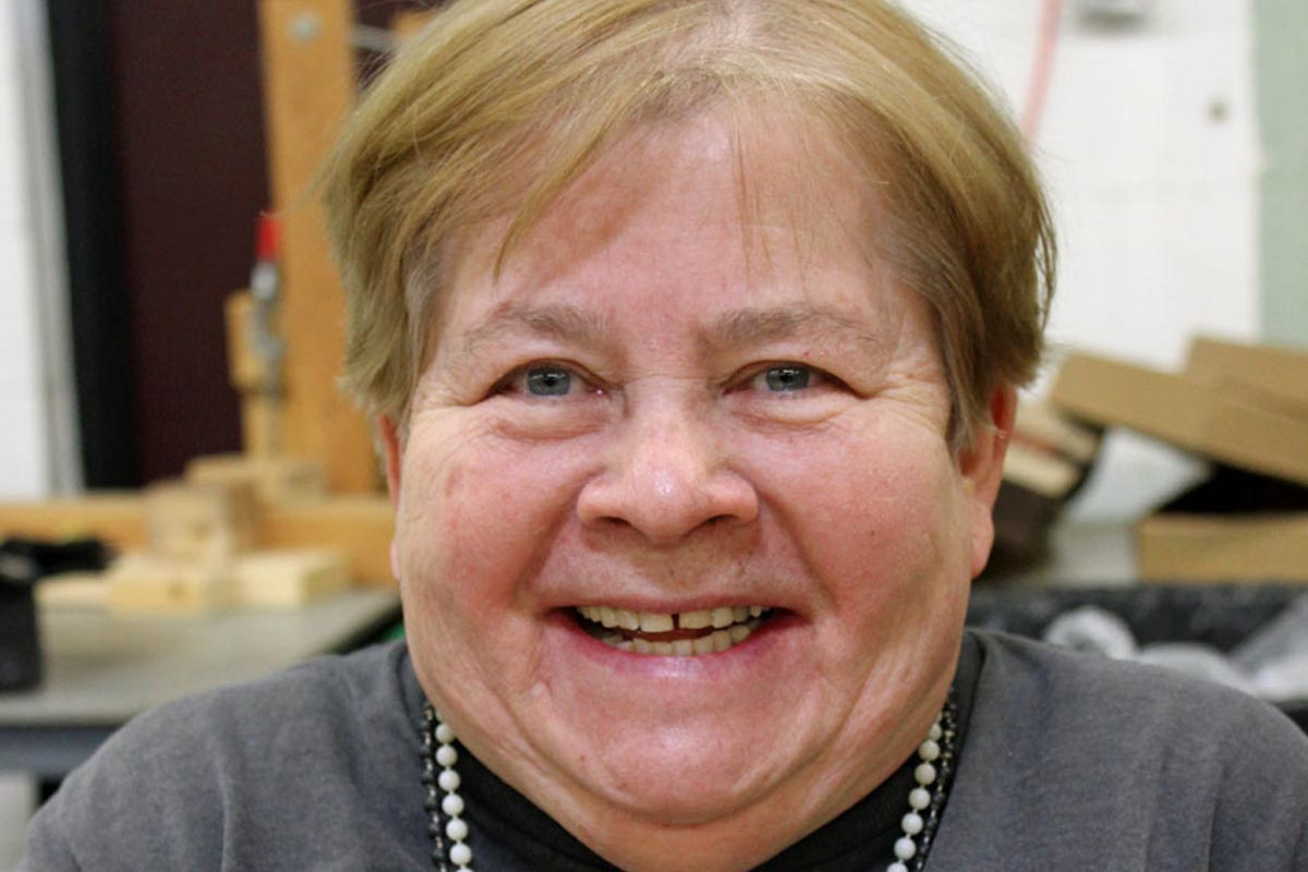advocacy for people with disabilities rise mn lady in pearls smiling