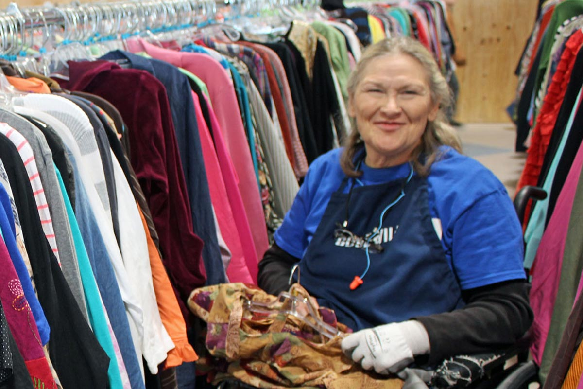 mn employment center lady restocking clothes at store