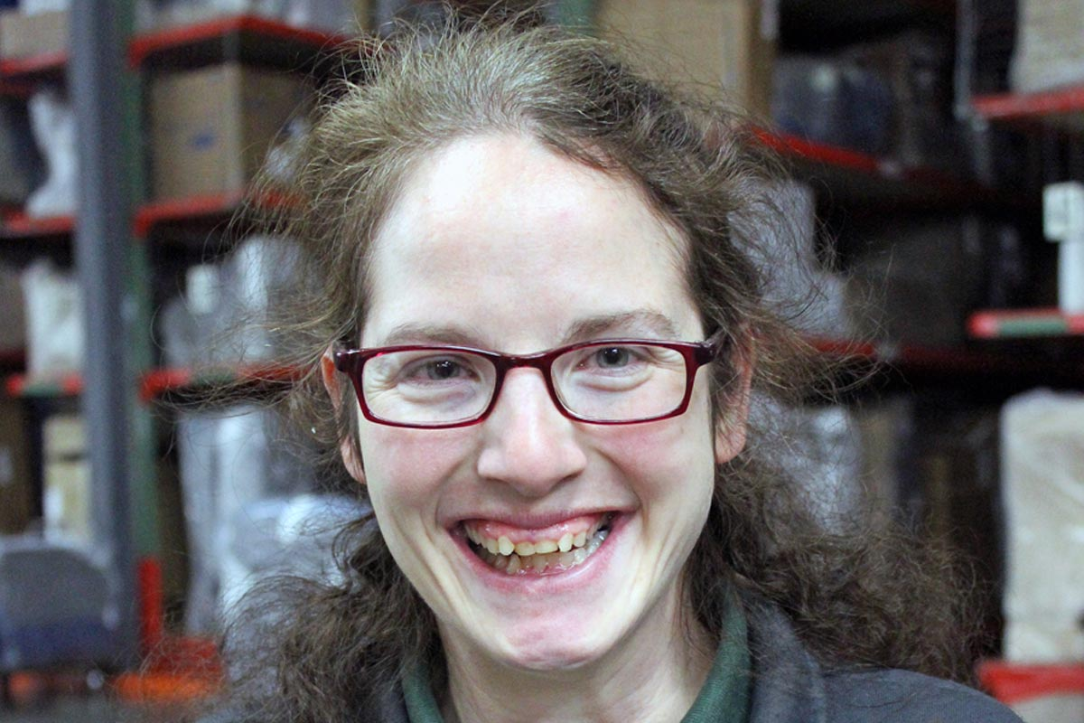 employment success stories minnesota rise lady in glasses standing in warehouse