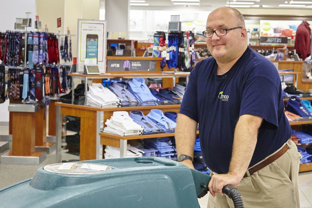 partner with rise to employ people with disabilities guy working at store