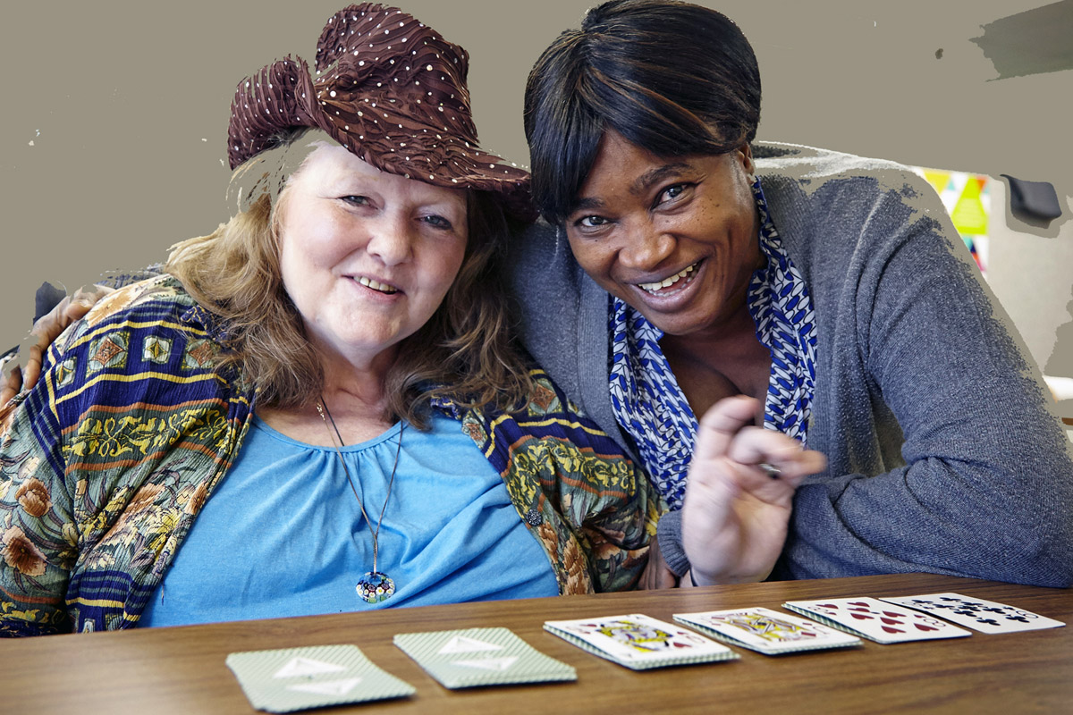 advocacy ladies playing cards smiling