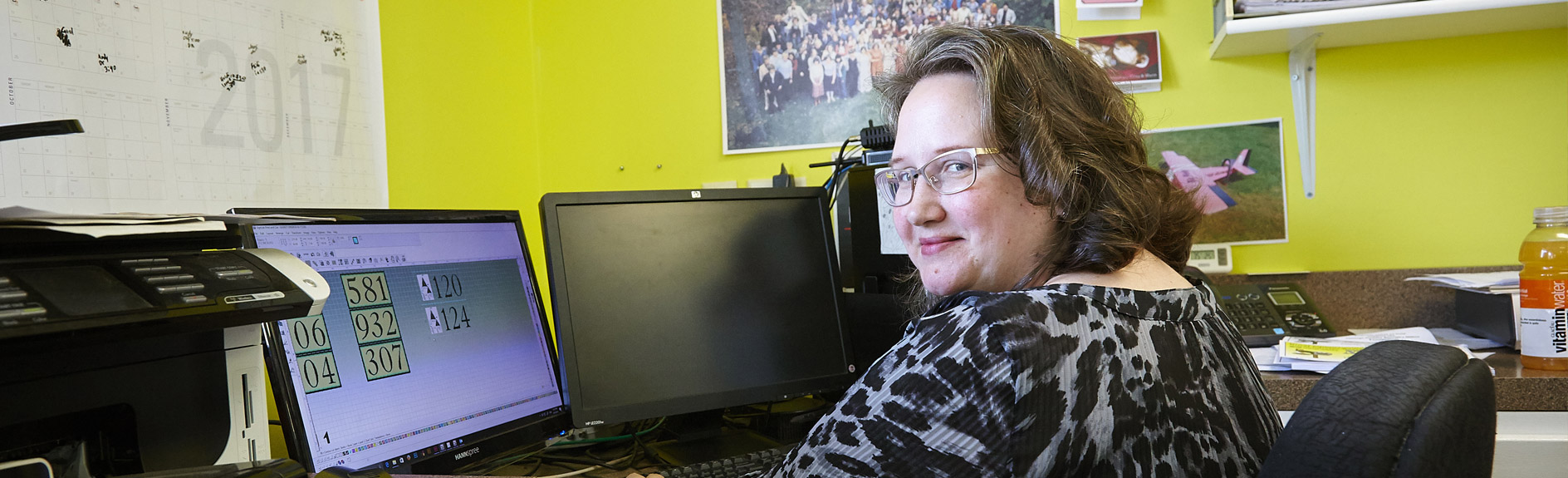 mental health and housing support services lady working behind computers