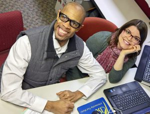 minnesota employment center pair smiling at desk