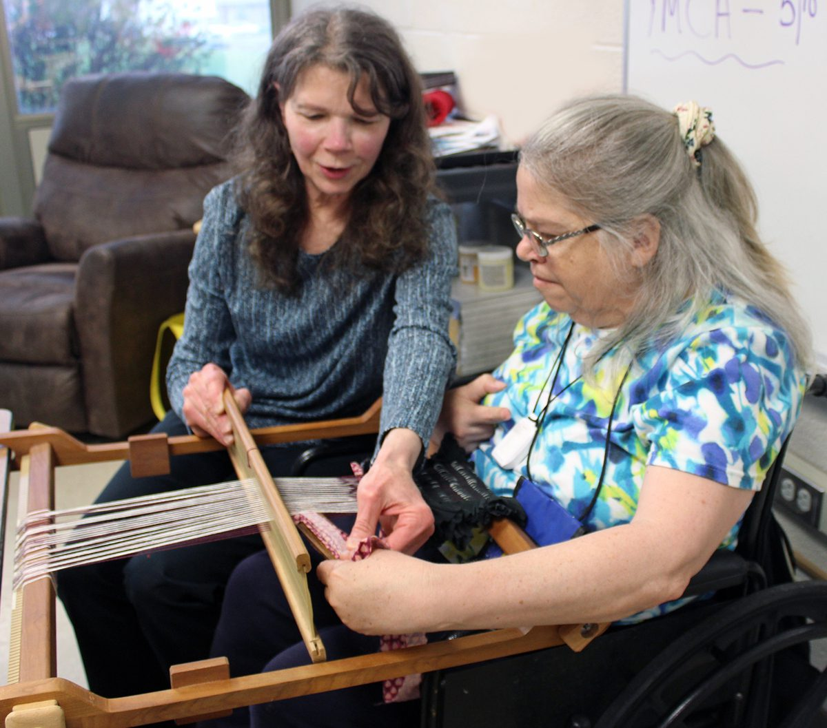 Volunteer Kay Rosenthal assists people explore their creative sides